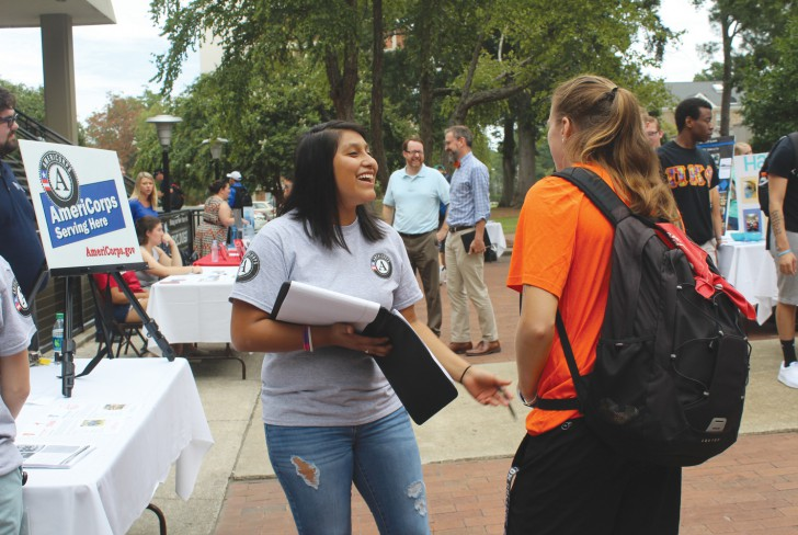 AmeriCorps VISTA members talk with students at Barton College at an event held on campus last week. Five members of the VISTA program have begun year-long service projects with partner agencies in Wilson. Contributed Photo